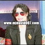 Michael Jackson wearing a red bracelet